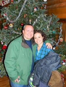 John Graning and Sunny Foote pose for a photo in front of the 15-foot Christmas Tree.