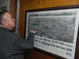 Dennis Gleeson shows a map depicting the impact the Cheney Brothers silk mills in Manchester, CT had on the growth and development of the town.