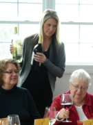 Beautiful Maryann pours the wine.