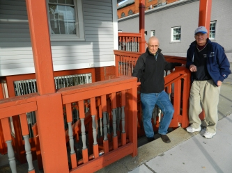 """Bill Shea, president of Bigg Play and """"Mooney"""" Haddad, vice president are shown by the steps of the old Remy's Grinder Store, known as the dugout."""