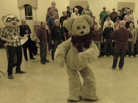 "Photo by Jacqueline Bennett Teddy Bear puppet played UConn Puppet arts major Hailey Bendar during a rehersal  with the Silk City Chorus of ""I'm Your Puppet."""