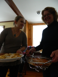 Michelle and Mary serve ouverdeves at Thanksgiving.
