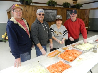 "Gary Jones (left), who suggested the ""Remy's Grinders"" fundraisers joined by other volunteers, is shown on Super Bowl Sunday, February 1, 2015 at Elks Lodge in Willimantic, CT."