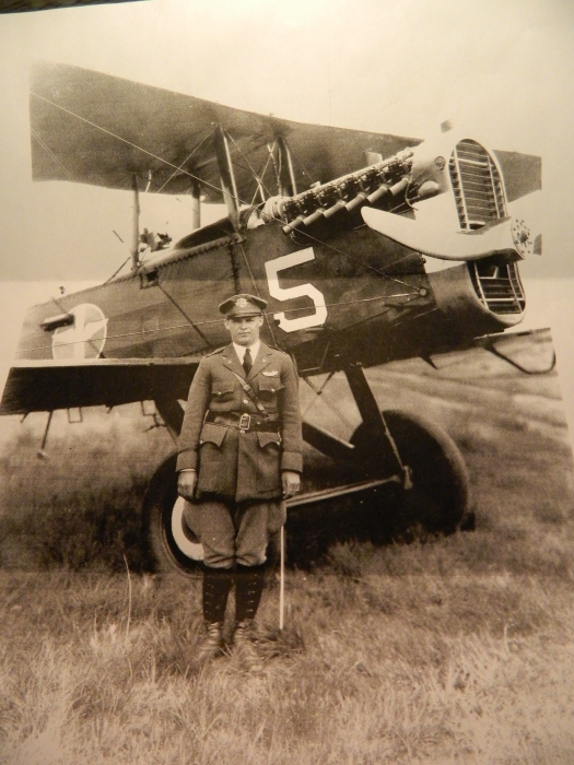 "Harry Generous, born in Chaplin, Connecticut, shown standing by his bi-plane in the 1930s; cousin to WWII bomber pilot Alfred R. Generous and WWII fighter pilot Oliver E. ""Bunker"" Generous. Harry Generous rose to the rank of colonel, organized the CT Air National Guard and was a commander of Patrick Air Force Base ."