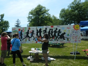 """Interactive Art Projects included """"Help Paint the Community Mural""""."""