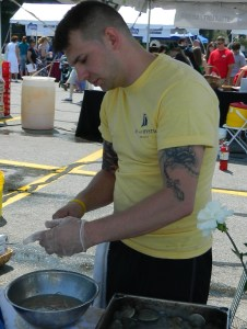 Shucking clams on the pot for the Harbour House booth at the Taste of Mystic.