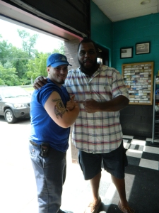 Jonathan DeMaio shows  his Washington Redskins tattoo to Chris Baker.