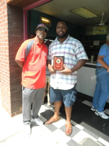 Kevin Kirksey, co-founder of the Greater Hartford Pro-Am, presents Chris Baker with a plaque for sponsoring a team.