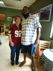 Carol Engelmann, owner of The Beanery and a loyal Redskins fan shown with #92 himself defensive lineman Chris Baker.