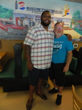 NFL's chris Baker and Windsor, Connecticut Mayor Donald Trinks, owner and general manager of Bart's Dive-In.