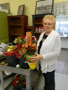 Pauline Hantilo shows a holiday arrangement.