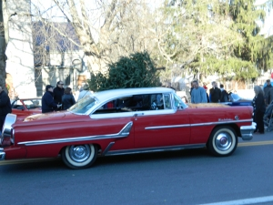 As seen in Rockwell's illustration - a 1955 red Mercury with Christmas Tree on top.