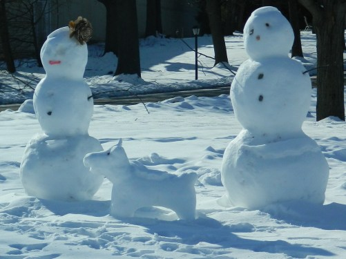 Mr. & Mrs. Snowman with a snow pup. North Main Street, Manchester,CT..