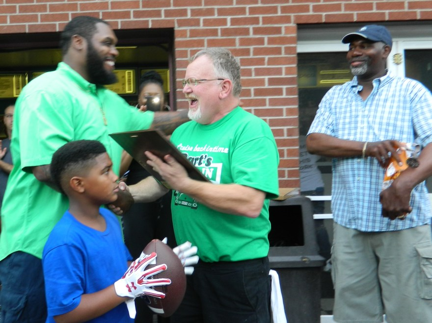 "Windsor native Chris Baker will host his annual football camp today July 9, 2016 in his hometown where last night Mayor Donald Trinks presented Chris with a proclamation declaring ""Chris 'Swaggy' Baker"" Day. The presentation took place  at Bart's Drive-In, a local institution."