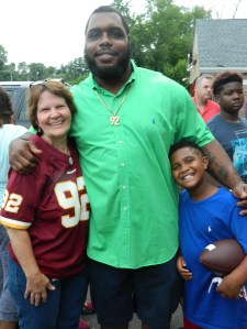 Carol englemann, owner and manager of the Beanery side of Bart's is a longtime Redskins fan - Carol and Chris are joined by his godson.