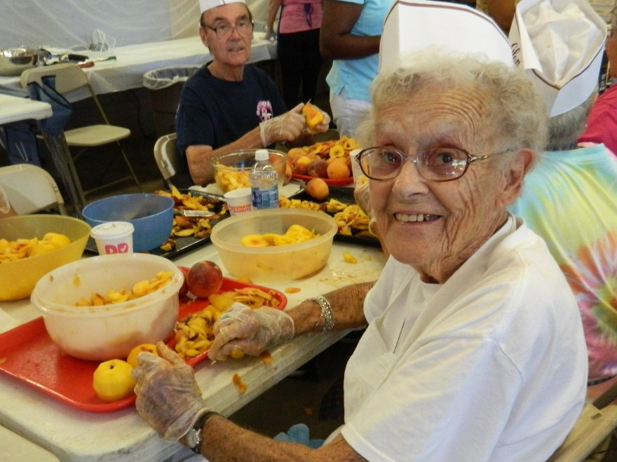Photo by Jacqueline Bennett  Jan Adams, 93, has been cutting peaches for the annual Eighth Utilies District fire Department Peach Festival for 40 years.