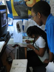 "Enia Jubrey with students researching the victims of 9/11 in order to decorate luminaries for the 2011 ""Walk of Light""."