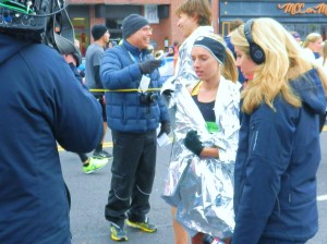 Women's winner Emily Sisson awaits the start of her post-race interview.