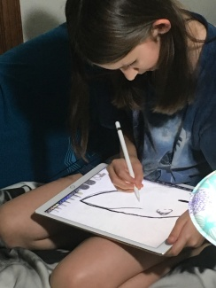 Courtesy photo - Sofia hard at work on her drawing.