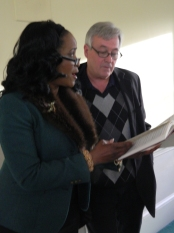 "Angela Griffin and T. J. Donohue share a hymn book and sing together ""We Shall Overcome."""