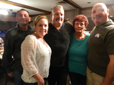 The folks who made it happen ..Officer Steve Vesco surrounded 2/24/2017 at Jim's Pizza, Windsor, CT by colleagues and friends who spearheaded a gofundme campaign and fundraiser to help K-9 Iko - Wayne and Kimberly Cabral, Debbie Samsom and Mark Rudiweic.